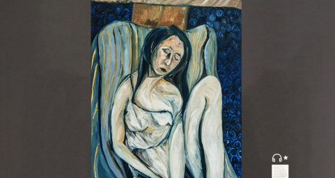 woman with herself on a sofa.