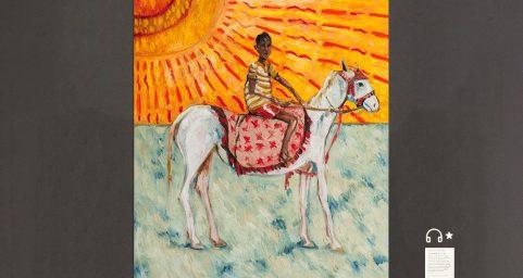 a boy riding a horse.